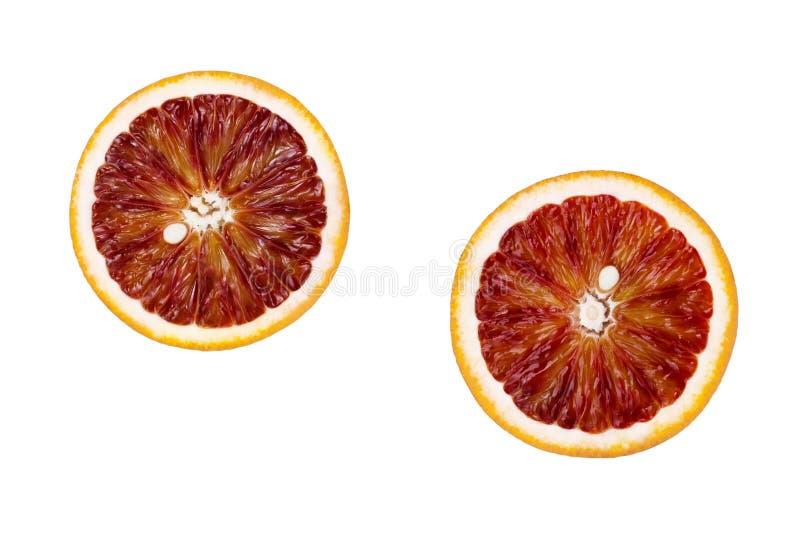 Corte rojo de la fruta de la naranja de sangre en los círculos aislados en el fondo blanco imágenes de archivo libres de regalías