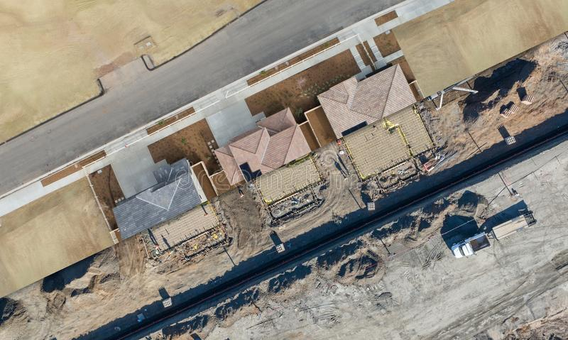 Corte transversal de la opinión aérea del abejón de los emplazamientos de la obra caseros fotos de archivo libres de regalías