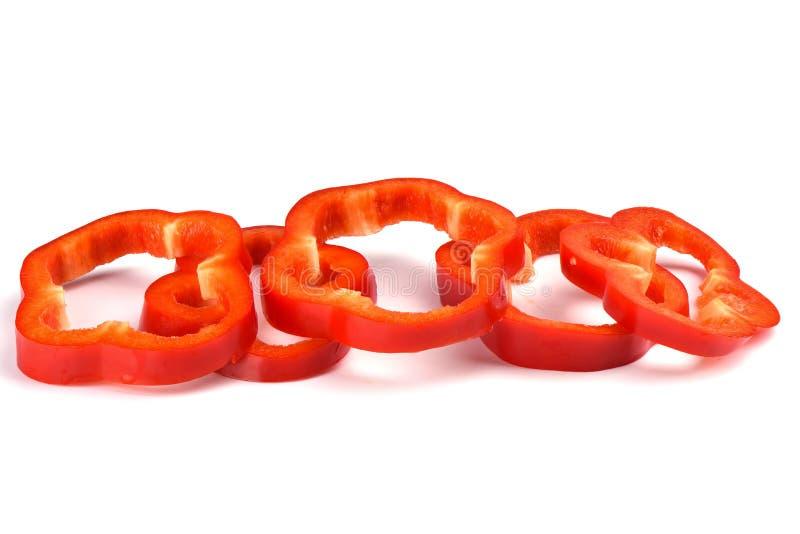 Corte vermelho da pimenta de sino em partes no fundo branco imagens de stock royalty free