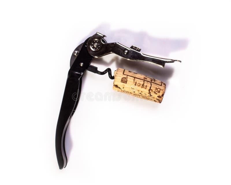 Cortiça com rolha de vinho sobre fundo branco imagem de stock