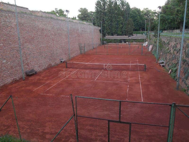 Corti di tennis arancioni fotografia stock libera da diritti