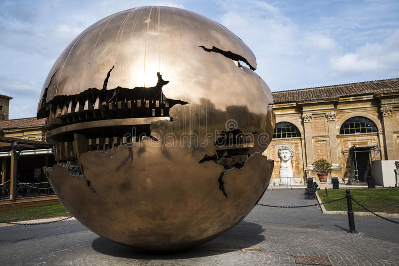 Cortile della Pigna. Sphere within a sphere by Pomodoro 1990 in the Gardens of the Vatican Museums in Rome Italy stock image