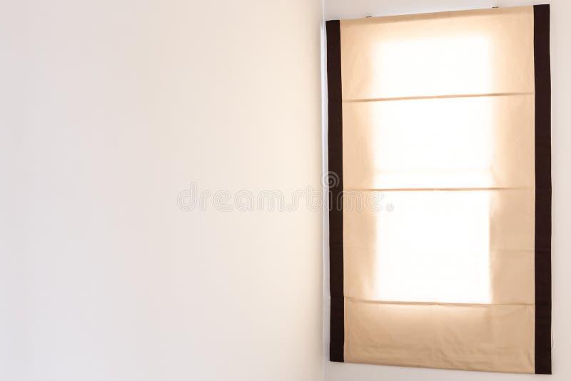 Cortina para esconder a luz solar foto de stock