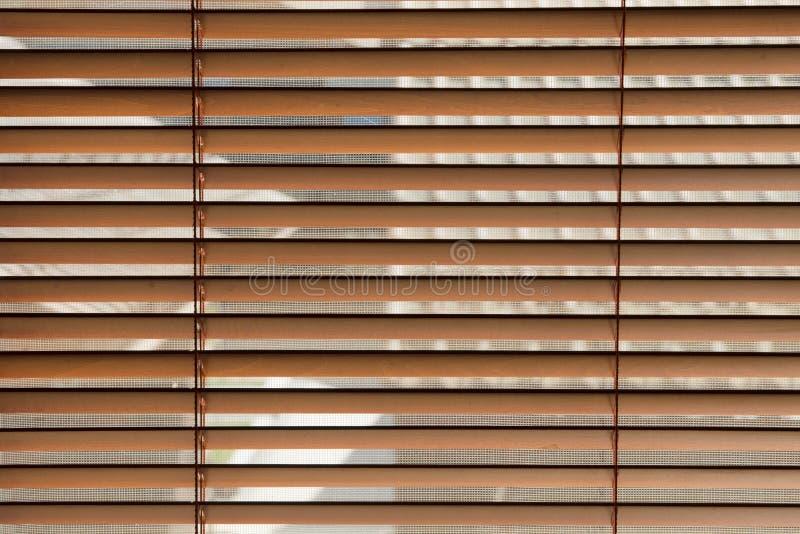 Cortinas de janela de madeira imagem de stock