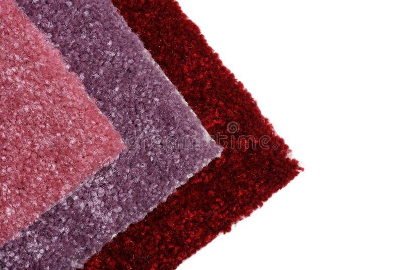 Cortinas de las muestras de la alfombra roja imagenes de archivo
