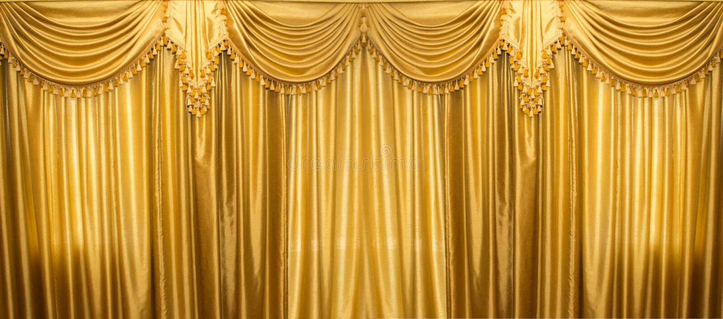 Cortinas del oro en etapa imagen de archivo