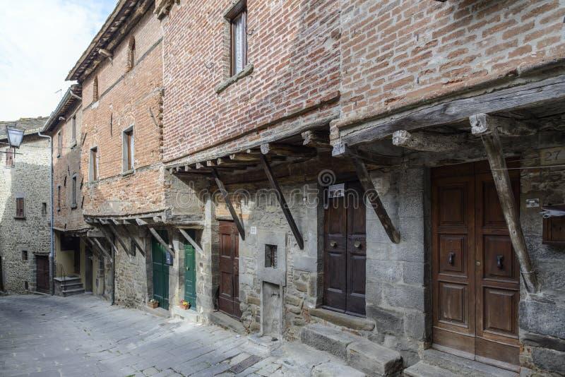 Cortona, Ареццо, Тоскана, Италия, Европа, средневековые дома стоковое фото rf