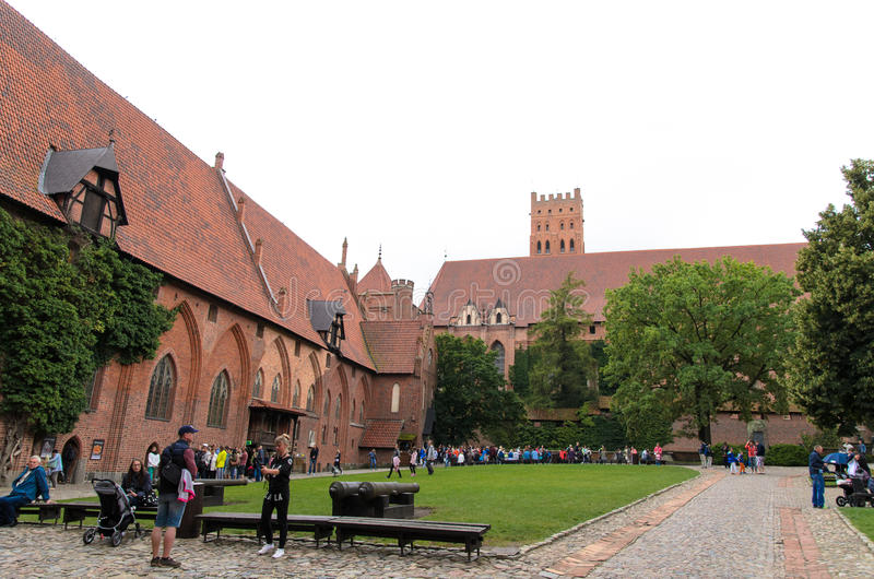 Cortyard of the biggest castle in Europe. Cortyard of Malbork castle in Poland. The castle built in gothic style used to be Teutonic Order residence stock image