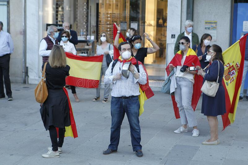 Spanish protester with face mask protesting touching a saucepan against the management of the government of Spain during the covid royalty free stock photos