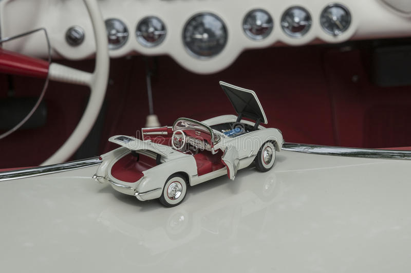 Corvette die cast. Concours d'élégance chambly 18-19 july 2015. Picture of white chevrolet corvette convertible die cast sitting in the real and same royalty free stock image