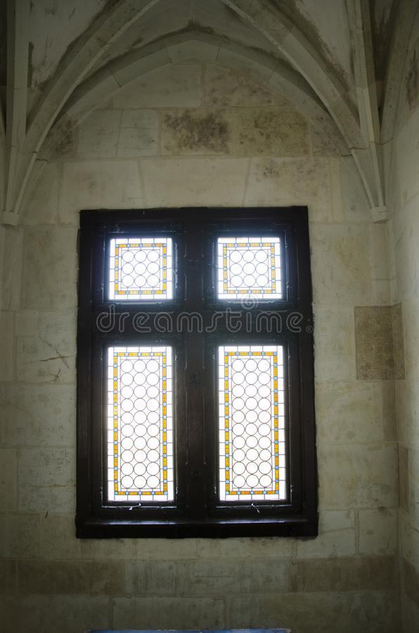 Corvin Castle inside window. Is a Gothic-Renaissance castle in Hunedoara, Romania. It is one of the largest castles in Europe and figures in a list of the Seven stock photos