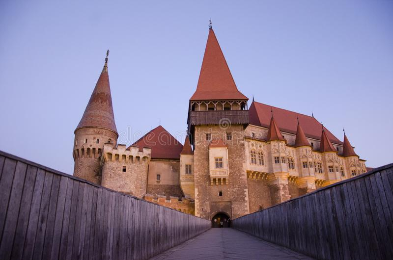 Corvin Castle panoramic view. Is a Gothic-Renaissance castle in Hunedoara, Romania. It is one of the largest castles in Europe and figures in a list of the Seven stock photography