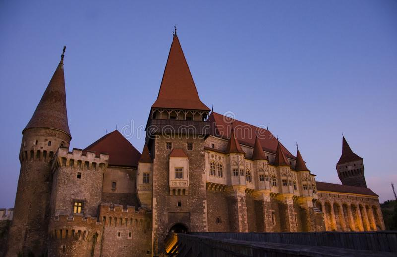 Corvin Castle, panoramic view by night. Is a Gothic-Renaissance castle in Hunedoara, Romania. It is one of the largest castles in Europe and figures in a list of royalty free stock photos