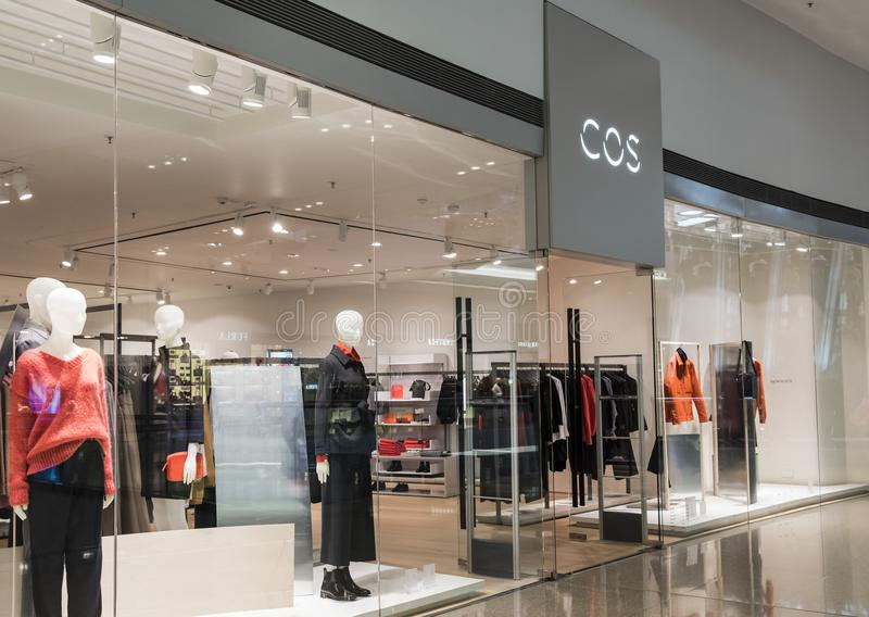 A COS store in Hong Kong. COS Collection of Style is the upscale brand of Swedish retailer H&M. royalty free stock image