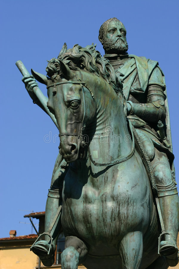 Cosimo Medici statue in Florence, Italy. Against a blue sky royalty free stock photos