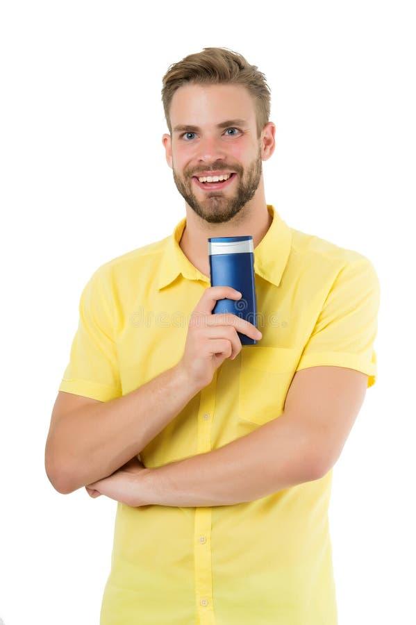 Cosmético de Bodycare para o banho ou o chuveiro Sorriso farpado do homem com o tubo do gel isolado no branco Preparação do barbe fotos de stock