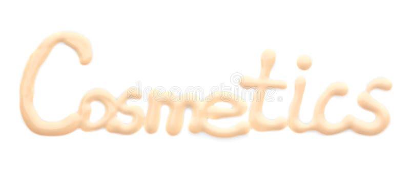 COSMÉTICOS de la palabra escritos con la fundación del tono de piel en el fondo blanco imagen de archivo