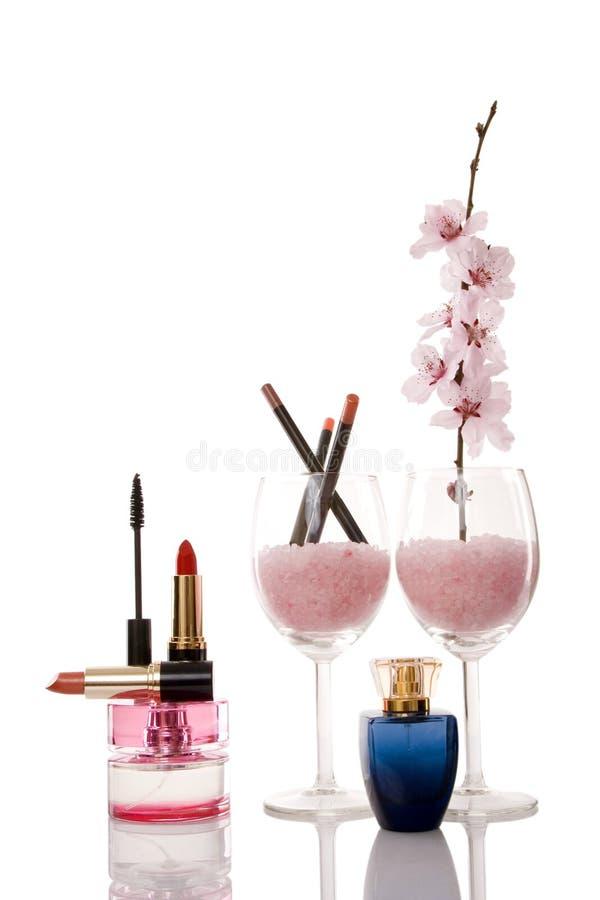 Cosméticos e flor da cereja imagem de stock