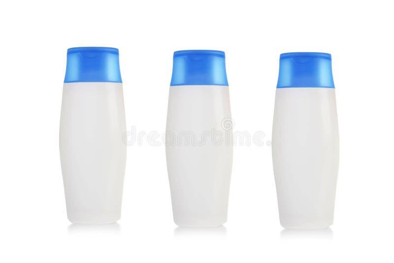 Cosméticos plásticos, botellas del champú imagenes de archivo