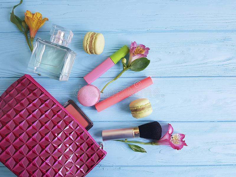 Cosmetic bag, blue wooden macaron,glamour fashion visage accessory flowers, mascara, alstroemeria stock images