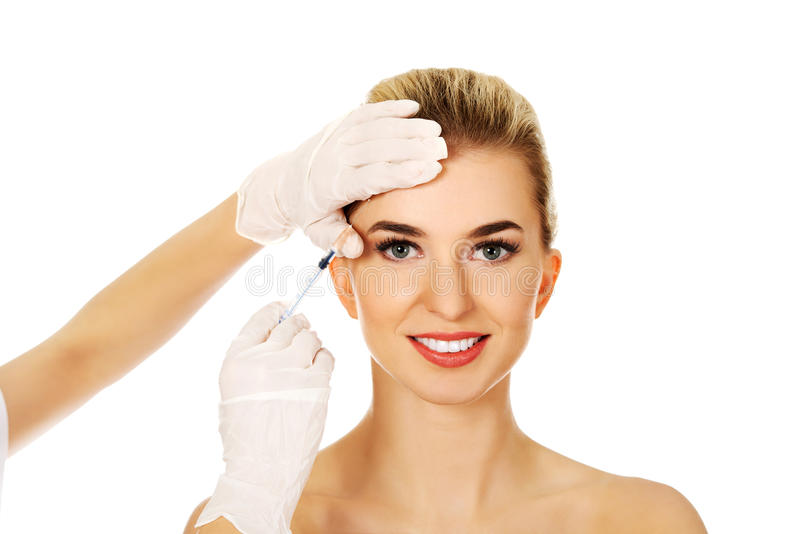 Cosmetic botox facial injection. Young woman has a cosmetic botox facial injection stock images