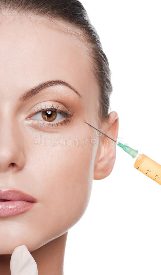 Cosmetic botox injection in the beauty face stock images