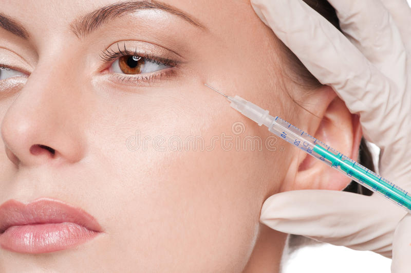 Cosmetic botox injection in the beauty face. Cosmetic botox injection in the female face. Eye zone. Isolated stock image