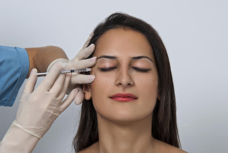 Cosmetic botox injection in the female face stock photos