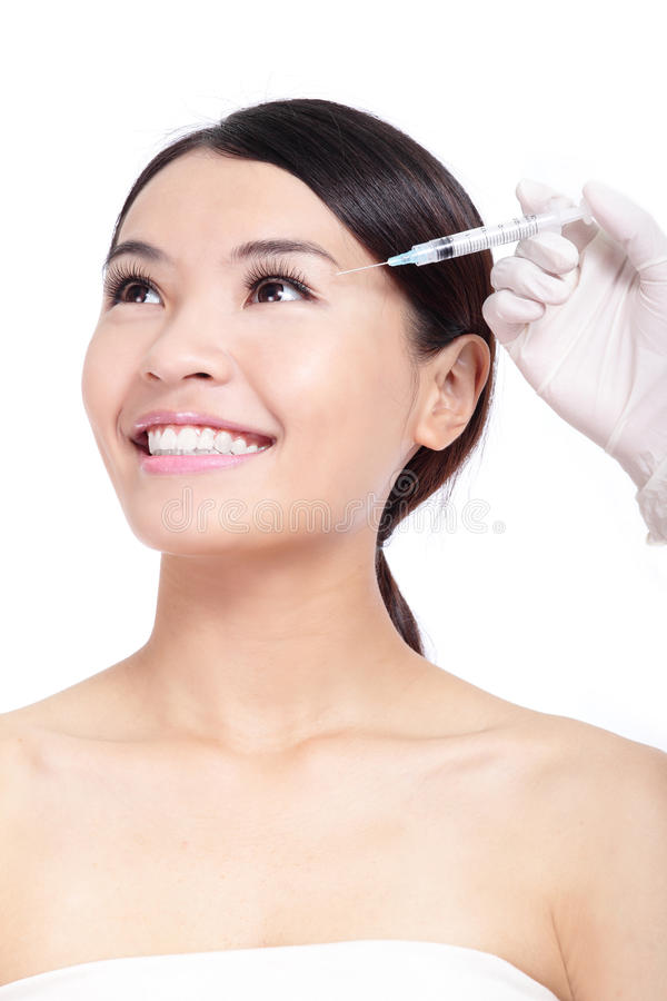 Cosmetic botox injection in woman face stock photos