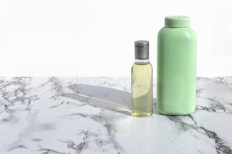 Cosmetic bottle with liquid for cleansing face or make up remover on marble background. Natural organic skin care beauty products.  royalty free stock photos