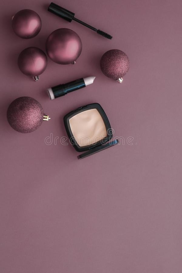 Make-up and cosmetics product set for beauty brand Christmas sale promotion, luxury purple flatlay background as holiday design royalty free stock images