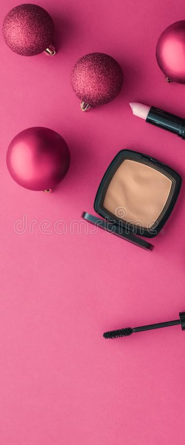 Make-up and cosmetics product set for beauty brand Christmas sale promotion, luxury pink flatlay background as holiday design. Cosmetic branding, fashion blog stock images