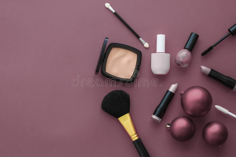 Make-up and cosmetics product set for beauty brand Christmas sale promotion, luxury purple flatlay background as holiday design. Cosmetic branding, fashion blog stock photo