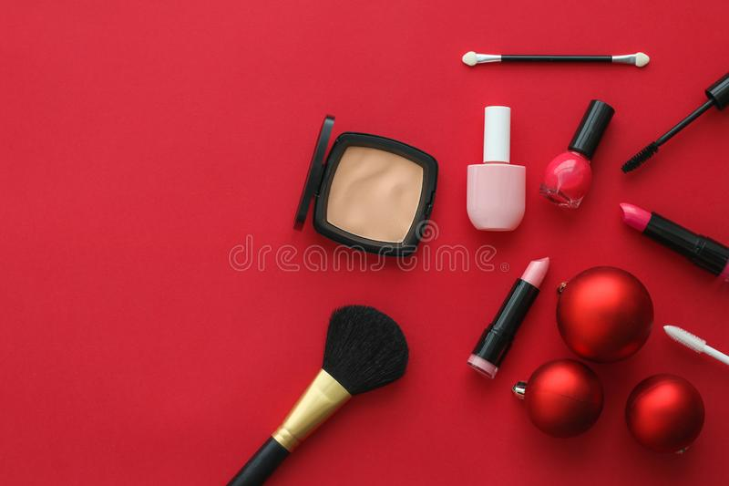 Make-up and cosmetics product set for beauty brand Christmas sale promotion, luxury red flatlay background as holiday design. Cosmetic branding, fashion blog royalty free stock photography