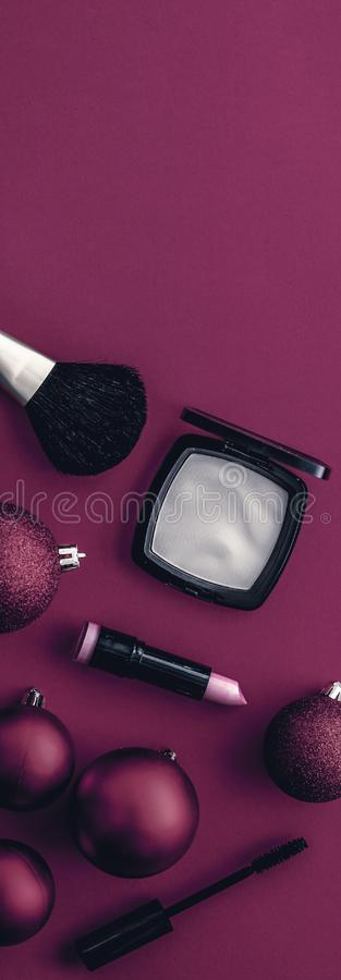 Make-up and cosmetics product set for beauty brand Christmas sale promotion, luxury magenta flatlay background as holiday design. Cosmetic branding, fashion blog royalty free stock photos