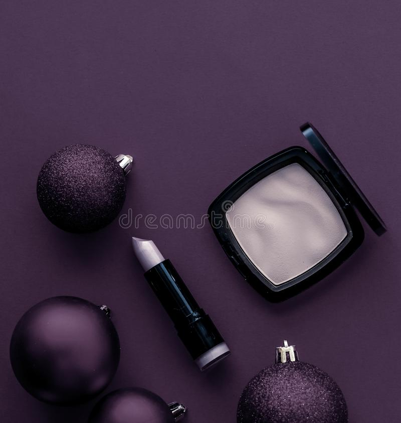 Make-up and cosmetics product set for beauty brand Christmas sale promotion, luxury plum flatlay background as holiday design. Cosmetic branding, fashion blog royalty free stock image