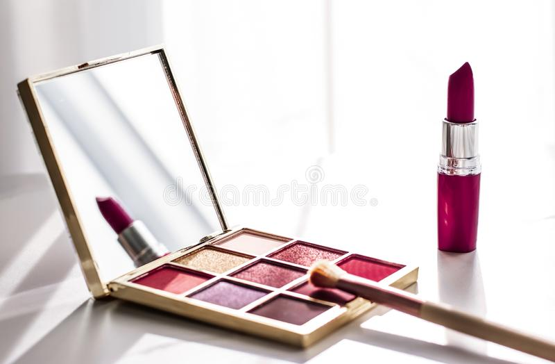 Cosmetics, makeup products set on marble vanity table, lipstick, eyeshadows and make-up brush for luxury beauty and fashion brand royalty free stock photo