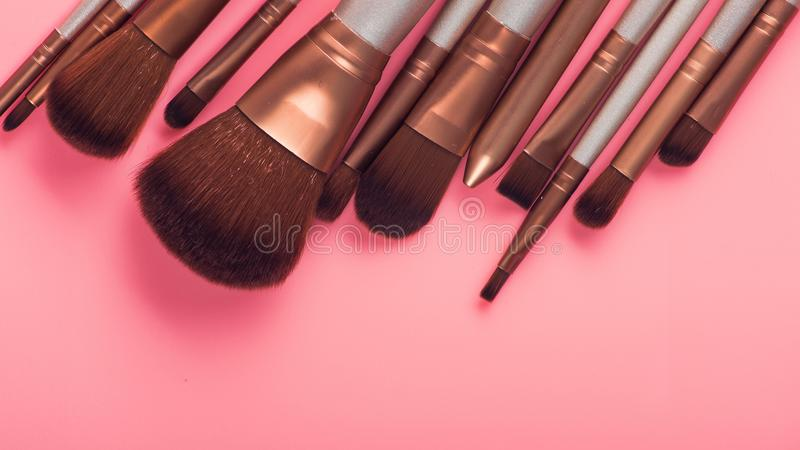 Cosmetic brush for beauty makeup. On pink background stock photo