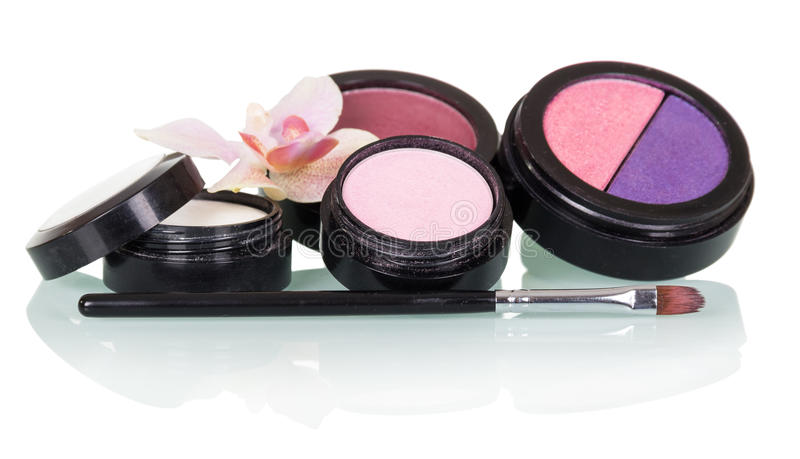 Cosmetic brush for makeup, eye shadow, blush and orchid flower isolated on white stock images