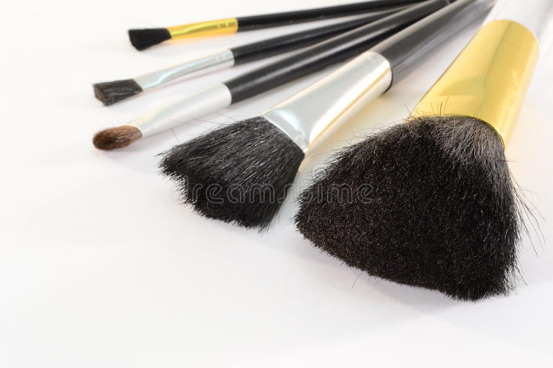Cosmetic brushes. Five cosmetic brushes isolated on white background stock photo