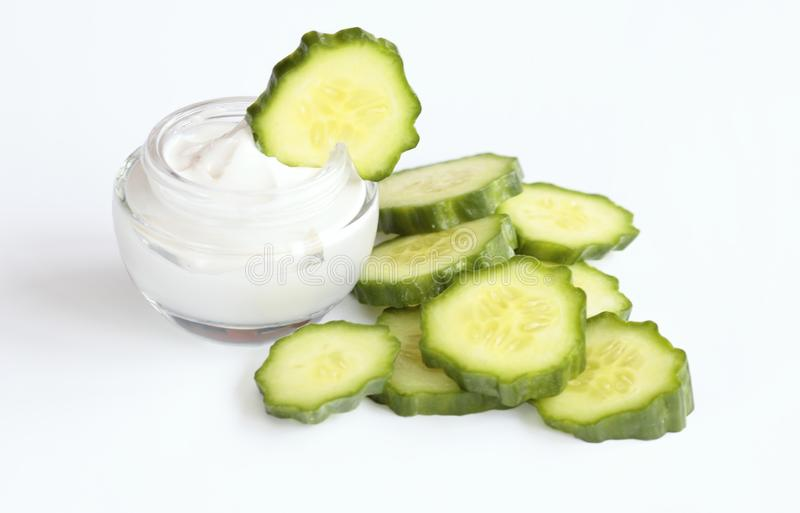 Cosmetic cream. Face cream and cucumber symbol for freshness royalty free stock photo
