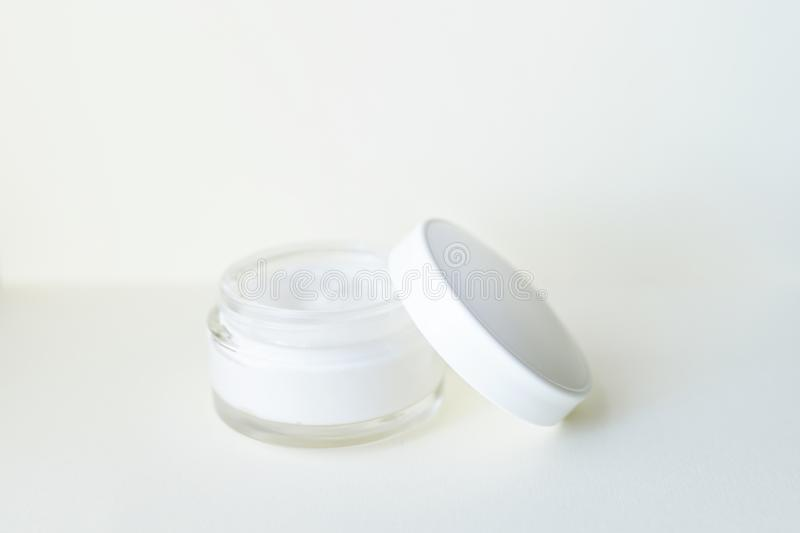 Cosmetic cream container on white background from top view . copy space . skin body face care concept stock photography