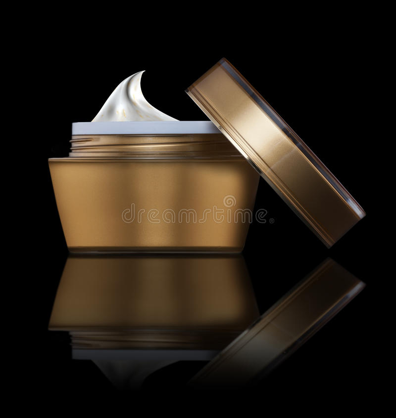 Cosmetic cream. Image is posed on dark background stock images