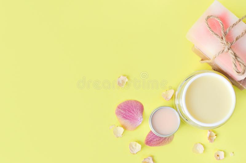 Cosmetic creams, lip balt on a yellow background.Spa beauty care. Space for a text. Copy space. spa flat lay. Pink, blue. The conc royalty free stock image