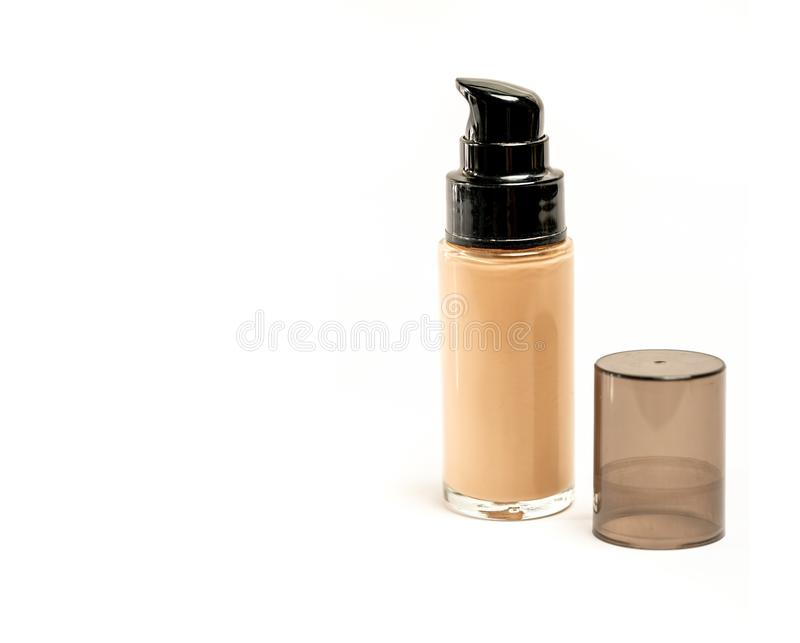 Cosmetic Foundation Bottle with Its Cap Open Beside It on White Background. And Copy Space for Text or Writing. Selective stock photo
