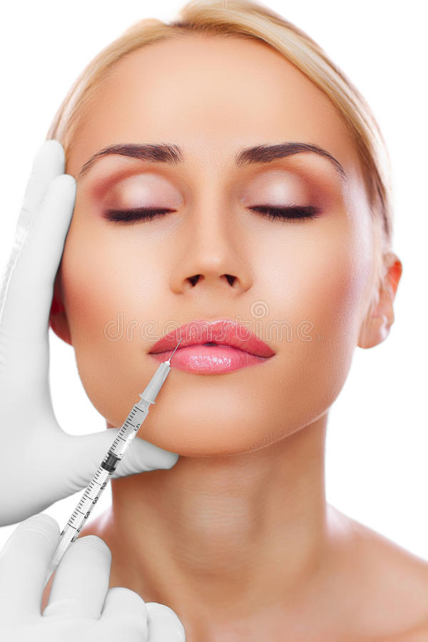 Cosmetic injection. To the pretty woman face stock photos