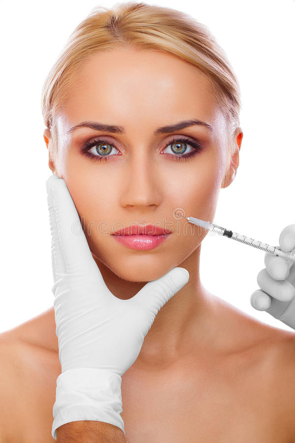 Cosmetic injection. To the pretty woman face royalty free stock images