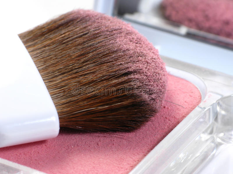 Cosmetic makeup. Cosmetic applicator and rosy blush royalty free stock photo