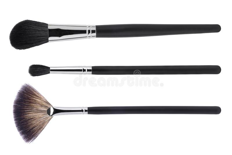 Cosmetic makeup brushes, isolated on a white background. Top view royalty free stock photo