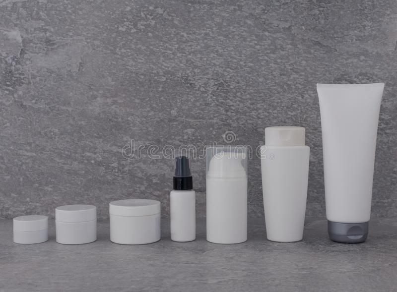 Cosmetic packaging set on grey background. group of skincare cream serum oil . facial beauty cosmetic spa product. natural. Cosmetology concept skin treatment stock images